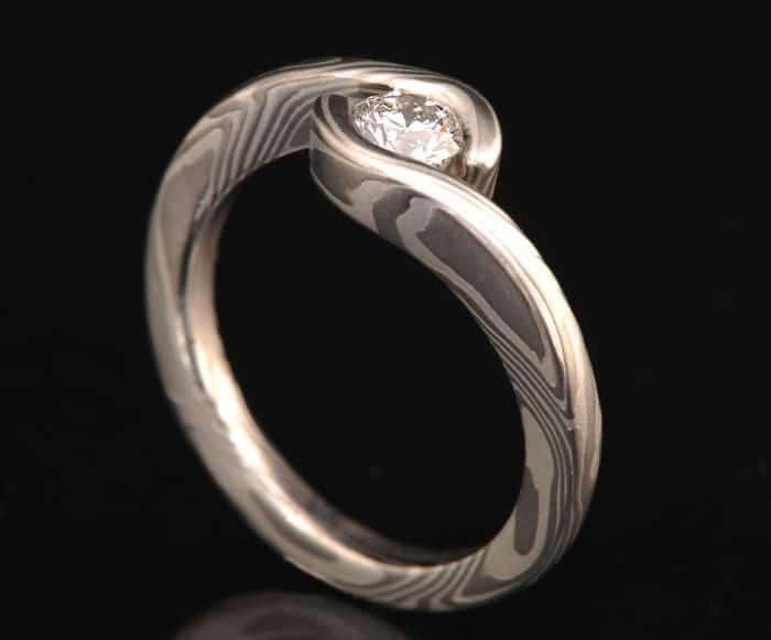 DIAMOND ENGAGEMENT RING with WRAP-AROUND SETTING