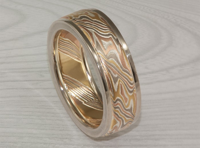 flat gold mokume wedding ring