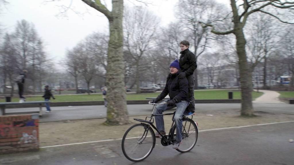 De fietser -vader en zoon