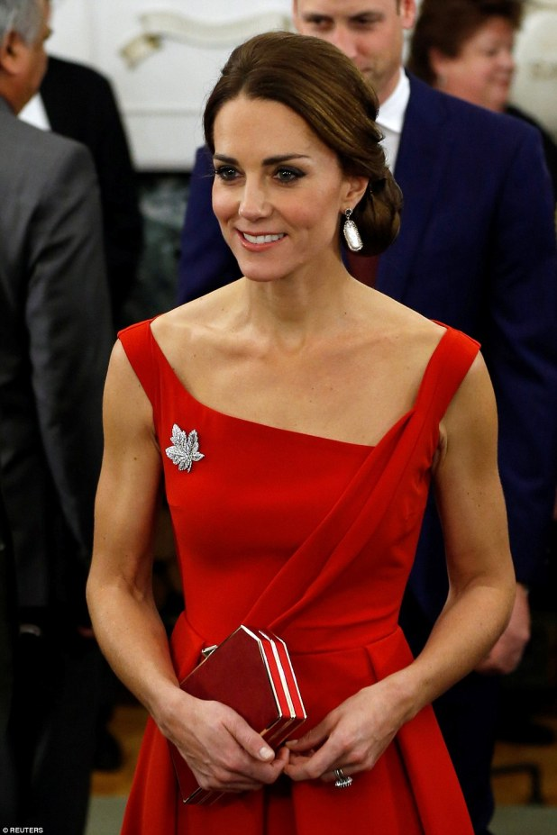 Shining example: Kate accessorised with a stunning broach paying homage to the Canadian flag and a matching red clutch bag as she turned heads at the reception