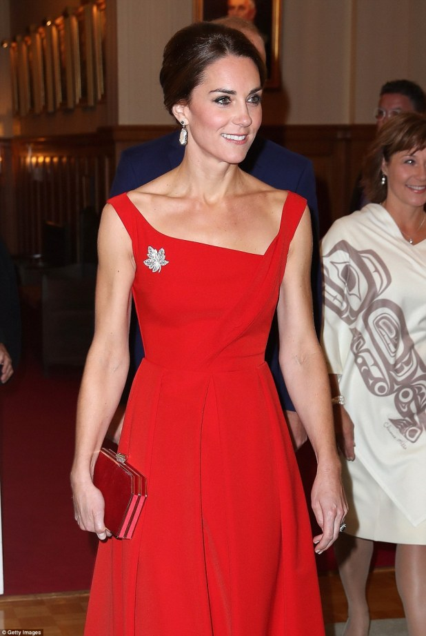 Turning heads: Kate looked stunning in her red dress and maple leaf brooch, paying homage yet again to the Canadian flag after the red and white patterned dress she wore on her first day in the country
