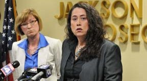 Laura O'Sullivan, legal director of the Midwest Innocence Project, with Jackson County Prosecutor Jean Peters Baker at left, announces on Friday, June 14, 2013, the release of Robert E. Nelson, who was convicted of a 1983 rape in Kansas City but exonerated after DNA evidence proved his innocence.