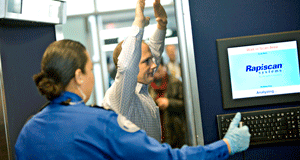 John Carter, a Transportation Security Administration (TSA) employee, center, is scanned during a demonstration of the Rapiscan Backscatter advanced imaging technology machine at Logan International airport in Boston, Massachusetts, U.S., on Friday, March 5, 2010. The machine allows security officers to conduct full-body scans of airline passengers. Photo by: Michael Fein/Bloomberg