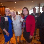 Women's Justice Award honoree Jennifer Gille Bacon surrounds herself with Woman of the Year alumni Doreen Dodson and Judge Laura Denvir Stith.