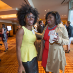 Women's Justice Award honoree Nicole Pleasant, on right, talks with her best friend and fellow Saint Louis University Law Student Umo Ironbar at the cocktail reception.