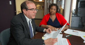 Legal Services of Eastern Missouri Executive Director Dan Glazier and Director of Development Courtney Simms go over some of the upcoming events and proposals for the agency in their offices on Forest Park Blvd. in St. Louis Wednesday. Photo by: KAREN ELSHOUT