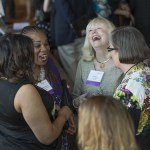 Woman of the Year 2015 Virginia Fry laughs along with her fellow honorees at the 2015 Women's Justice Awards reception in their honor at the Four Seasons Hotel in St. Louis.