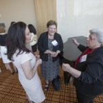 2015 WJA Honorees Judge Lisa Page and Edith Messina chat together with Mary Kay O'Malley listening in at the Women's Justice Award 2015 Awards banquet.