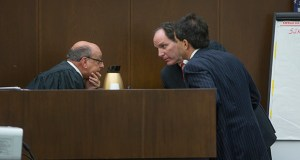 Judge Steven Goldman confers with the lead attorneys in the Monsanto PCB case as closing arguments are about to be presented to the jury after three weeks of testimony.  Monsanto's attorney, Thomas Goutman, of White and Williams law firm in Philadelpia, Pa., center,  and Steve Kherkher, for the plaintiffs,  of Williams Kherkher in Houston lean in to hear their instructions.