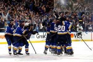 St. Louis Blues celebrate after defeating the Dallas Stars in double overtime in Game 7 of an NHL second-round hockey playoff series Tuesday, May 7, 2019, in St. Louis. The Blues won 2-1. (AP Photo/Jeff Roberson)