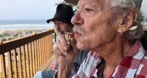 Two-time cancer survivor and medical marijuana cardholder Bill Blazina, 73, smokes a marijuana joint on the deck of his neighbor's home in Waldport, Ore. Blazina also uses a high-potency marijuana oil as a medical marijuana patient but he can't afford it at a recreational marijuana store. Blazina has learned how to make his own oil in a rice cooker after watching online videos. AP Photo by Gillian Flaccus