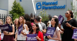 In this June 4, 2019, file photo, anti-abortion advocates gather outside the Planned Parenthood clinic in St. Louis. (AP Photo/Jeff Roberson, File)