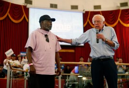 Democratic presidential candidate Sen. Bernie Sanders, right, I-Vt., shares the stage with home healthcare worker George Allen during a town hall meeting at the Victory Missionary Baptist Church in Las Vegas on Saturday, July 6, 2019. (Steve Marcus/Las Vegas Sun via AP)