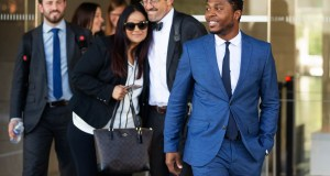 "Rapper Marcus Gray, right, smiles as his attorney, Michael A. Kahn, second from right, congratulates Gray's wife, Crystal, as they leave the federal courthouse in Los Angeles on Aug. 1. A jury has decided that Katy Perry, her collaborators and her record label must pay more than $2.78 million because the pop star's 2013 hit ""Dark Horse"" copied a Christian rap song by Gray. Perry's attorney said they plan to vigorously fight the decision. (AP Photo/Damian Dovarganes)"