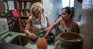 Vivien Tartter, left, visits with her house guest, Guatemalan immigrant Rosayra Pablo Cruz, in a downstairs apartment Tartter has made available to Cruz and her family, in New York. Tartter was connected to Pablo Cruz by the group Immigrant Families Together. AP Photo by Bebeto Matthews