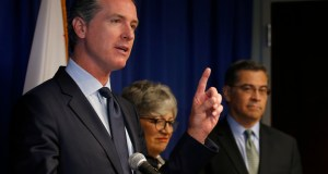 Gov. Gavin Newsom, left, flanked by California Air Resources Board Chair Mary Nichols and California Attorney General Xavier Becerra, discusses the Trump administration's pledge to revoke California's authority to set vehicle emissions standards that are different than the federal standards, during a news conference in Sacramento, Calif. AP Photo by Rich Pedroncelli