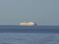 The ferry arrives off the horizon