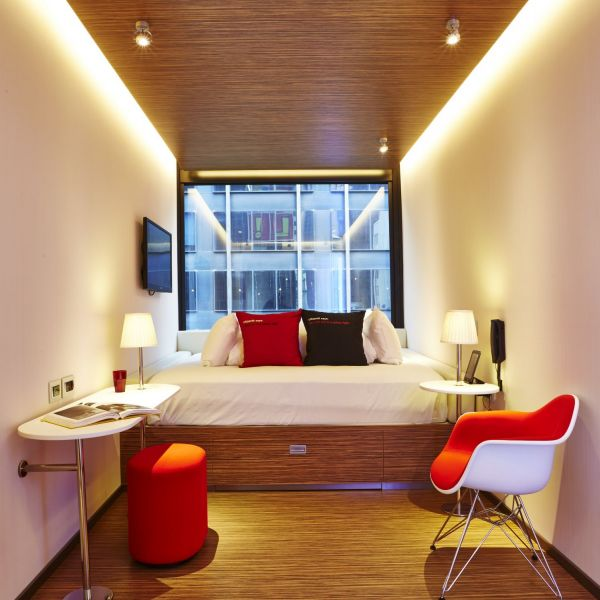 The red, black and white motif makes this micro hotel modern.