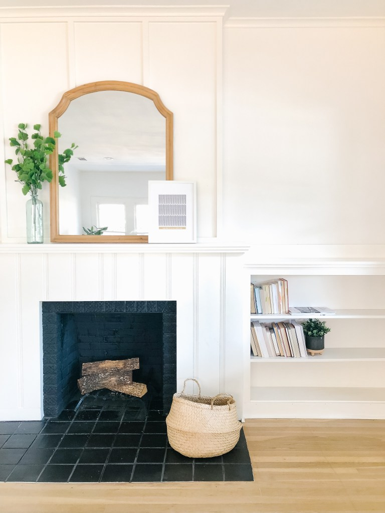 black and white fireplace shelves mantle brick | 102-year-old fixer upper house renovation | mid century modern Scandinavian home design | house flip reno