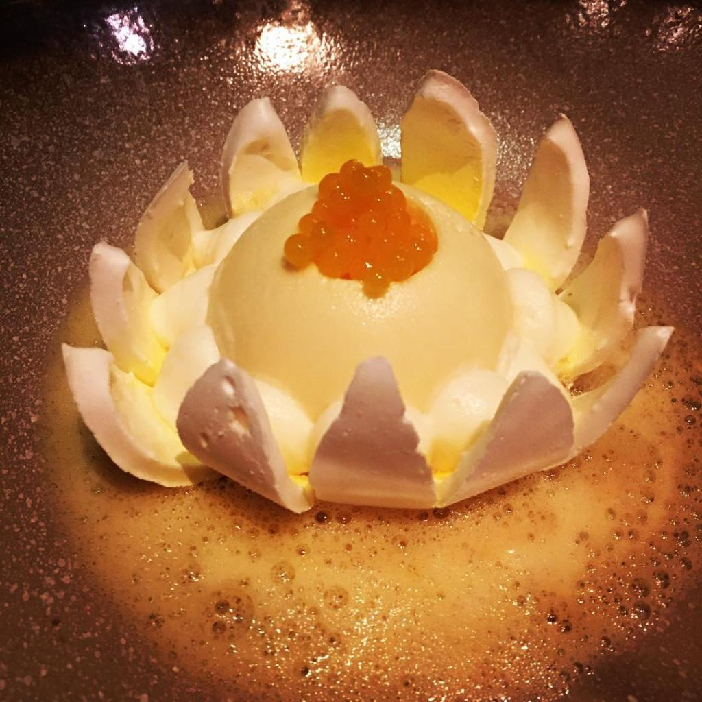 A passion fruit volcano with mango caviar Who new mangoshellip