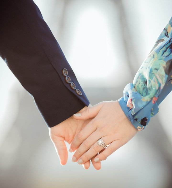 photo of hands and wedding ring