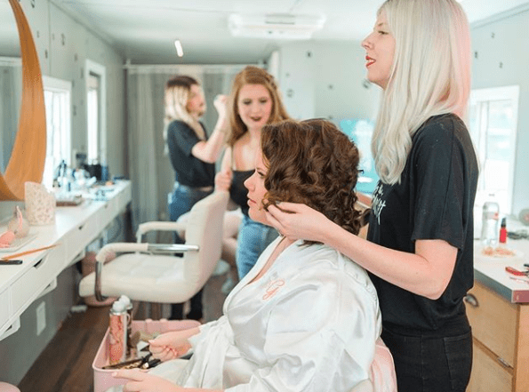 photo of Britnye dolling up a bride