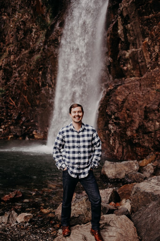 photo of Sean in front of Franklin Falls waterfall