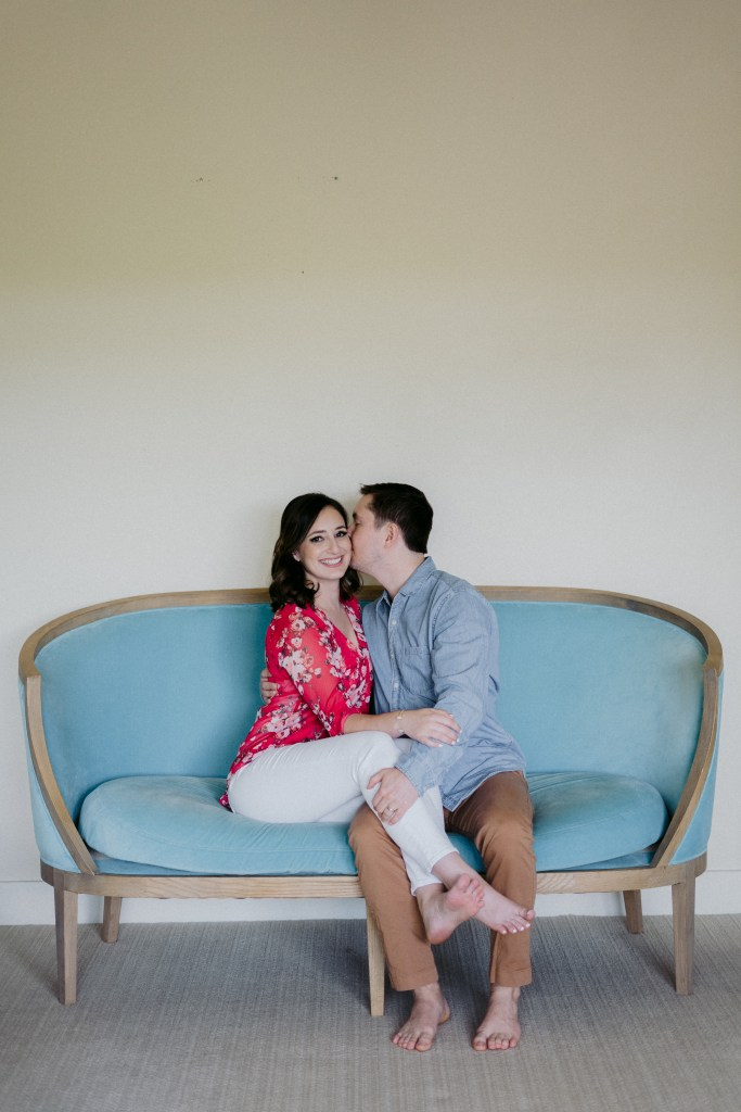 photo of couple on a bright blue couch