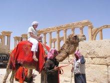 J__ riding a camel
