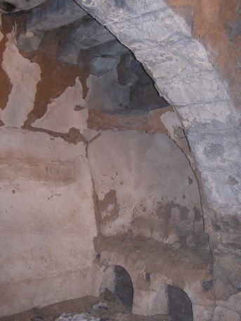 Inside old house at Tissia -- note the hen nests