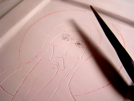 After transferring the image to the board, it is incised with a metal stylus tool, so that it will continue to be visible through the underpainting