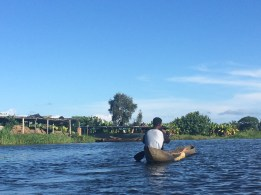 Local man canoeing down the Canal des Pangalanes