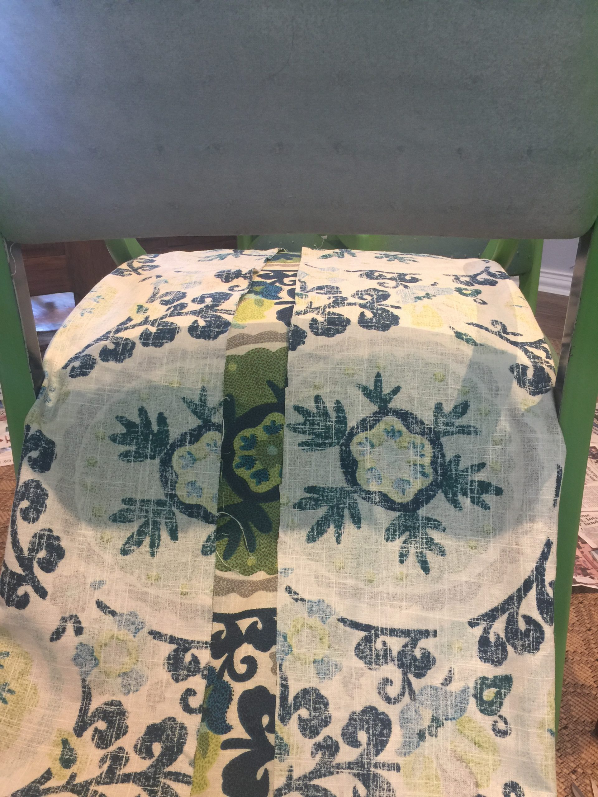 laying fabric on chair before cutting