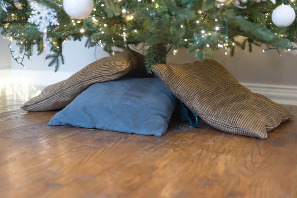 Pillows under the tree to fluff up tree skirt