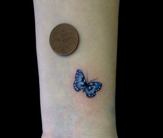 Tiny Blue Butterfly Tattoo