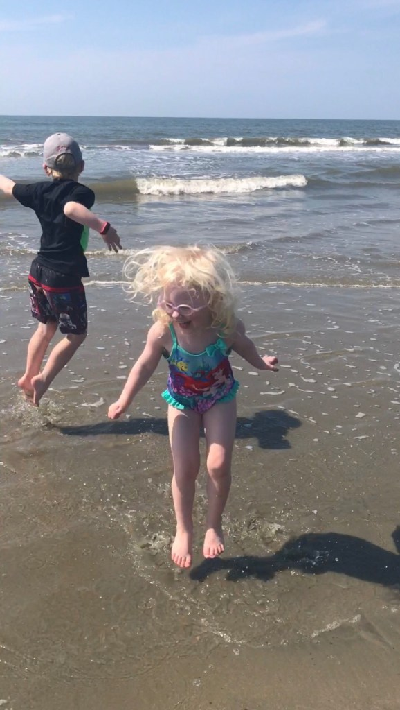 Kids jumping in the water at Isle of Palms