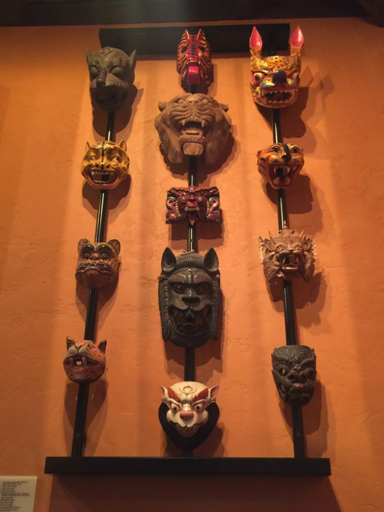 masks on walls at Tiffins
