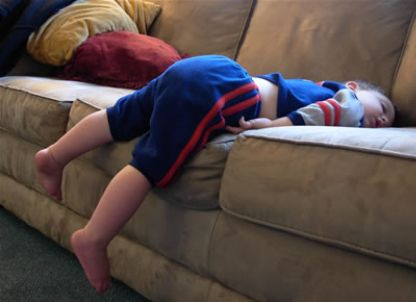 kid-sleeping-on-couch