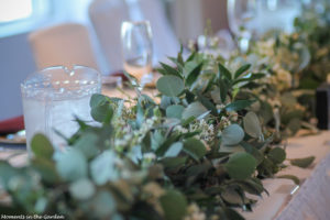 Eucalyptus boughs with waxed flowers interspersed-7183