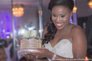 Bride presenting cake to mother-in-law
