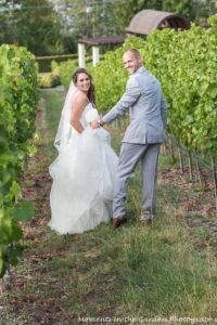 bride-and-groom-walking-down-vineyard-good