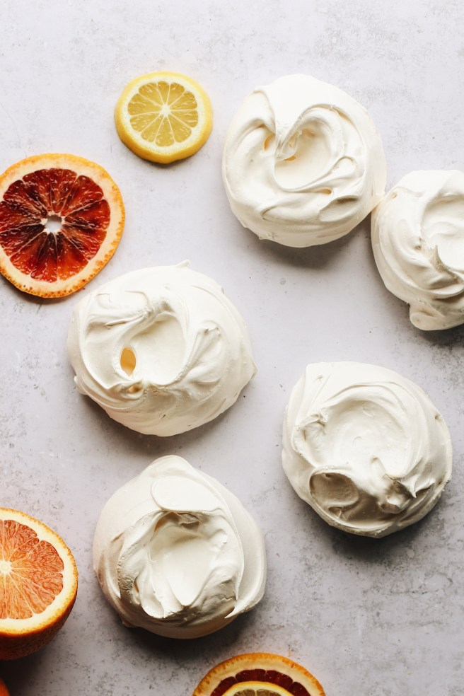 shows how the baked mini pavlovas should look. crispy smooth white exterior with concaved indent on top.