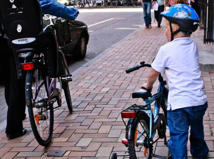 Kids biking to school in Odense, Denmark