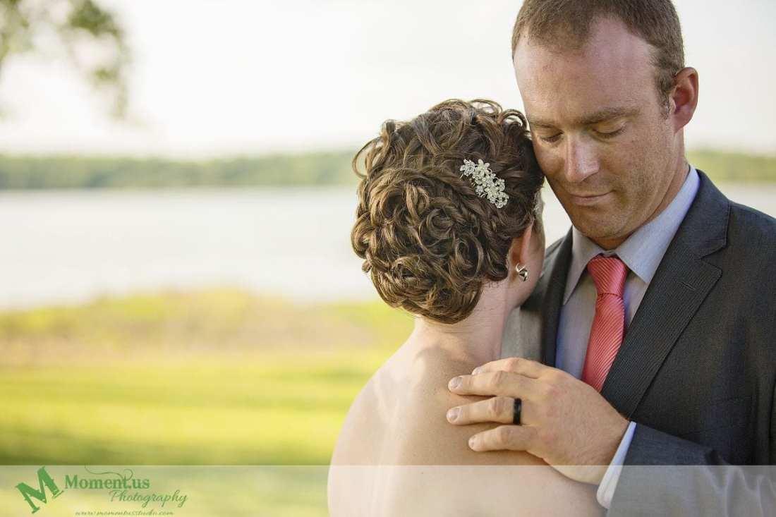 Outdoor Cornwall Wedding - groom touching bride's shoulder