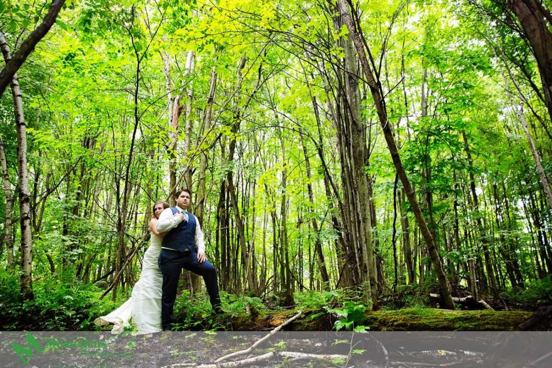 rustic country wedding photos - bride and groom cuddle in forest