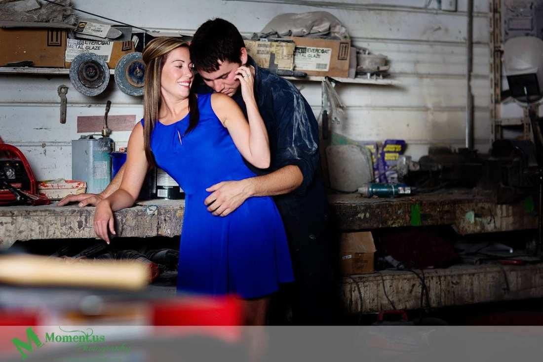 woman in blue dress elbow on workbench - Cornwall engagement session