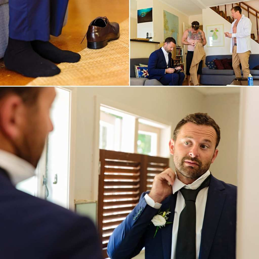 Cornwall international wedding photographer - groom fixing collar