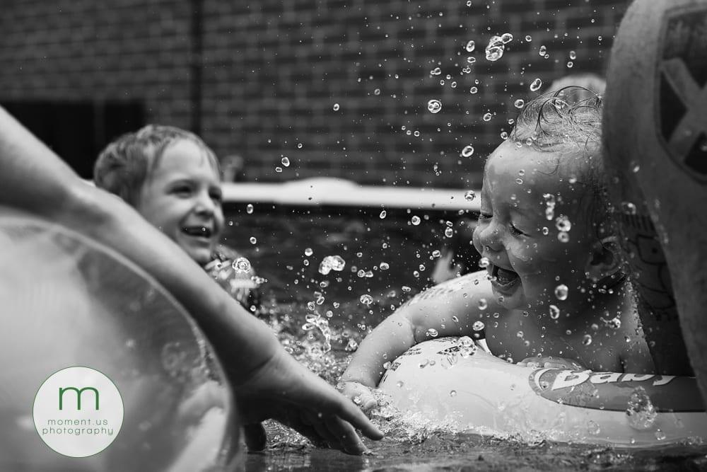 boy being splashed in face
