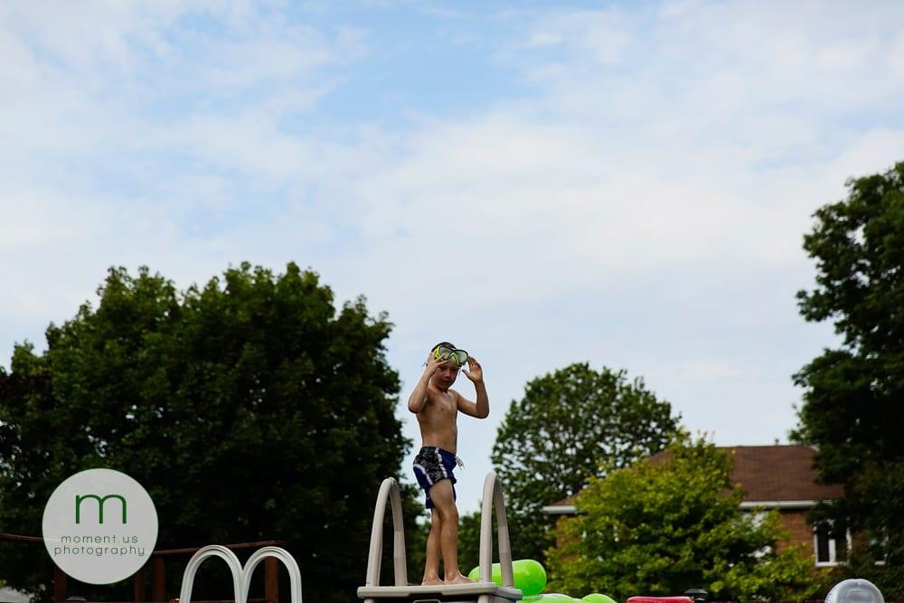 boy on pool ladder