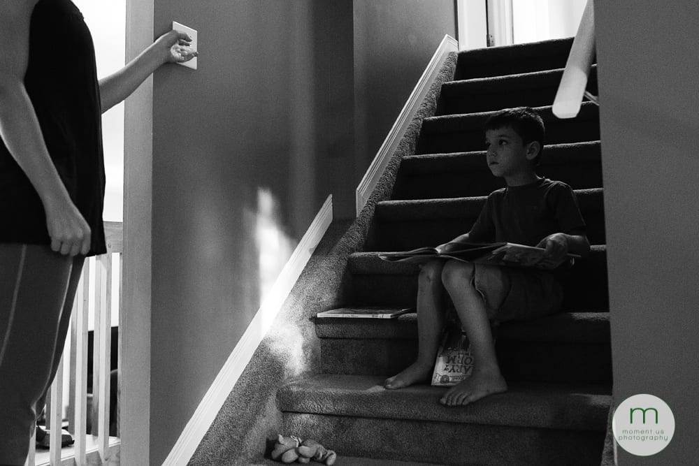 boy reading on staircase